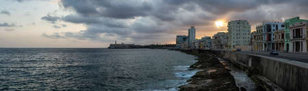 Beautiful panoramic view of the Old Havana City, Capital of Cuba, by the Ocean Coast during a dramatic and cloudy sunrise. Stock Photo