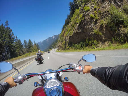 Riding on a motorcycle during a sunny summer day. Taken on Sea to Sky Highway near Squamish, North of Vancouver, BC, Canada