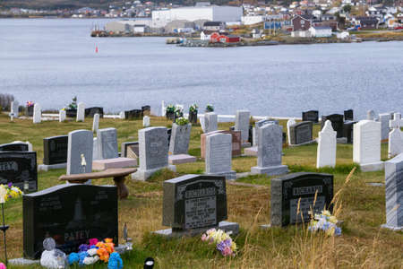 Cemetery in a small town on a rocky Atlantic Ocean Coast during a cloudy day. Taken in St. Anthony, Newfoundland, Canada. Archivio Fotografico