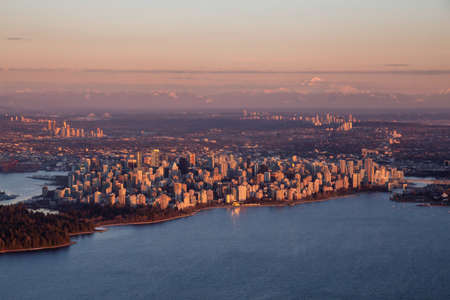 Aerial view of a modern Downtown City during a sunny winter sunset. Taken in Vancouver, British Columbia, Canada.