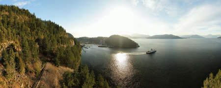 Aerial panoramic view of Horseshoe Bay Ferry Terminal during a sunny evening before sunset. Taken in West Vancouver, British Columbia, Canada. Stock Photo