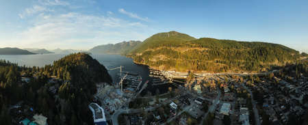Aerial panoramic view of Horseshoe Bay Ferry Terminal during a sunny evening before sunset. Taken in West Vancouver, British Columbia, Canada.