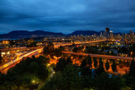 Aerial view of Downtown City during a cloudy summer night after sunset. Taken in Vancouver, British Columbia, Canada. 版權商用圖片