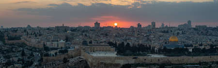 Beautiful panoramic aerial view of the Old City and Dome of the Rock during a dramatic colorful sunset. Taken in Jerusalem, Capital of Israel. Stock Photo