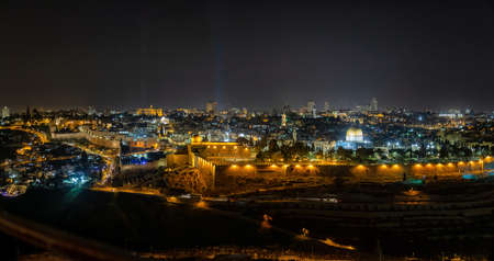 Beautiful aerial panoramic view of the Old City, Dome of the Rock and Tomb of the Prophets during night time. Taken in Jerusalem, Capital of Israel.