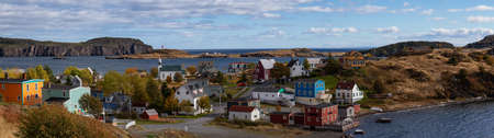 Aerial panoramic view of a small town on the Atlantic Ocean Coast during a sunny day. Taken in Trinity, Newfoundland and Labrador, Canada. Archivio Fotografico