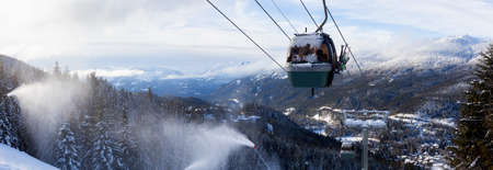 Whistler, British Columbia, Canada. Panoramic View of Gondola going up the mountain during a vibrant and sunny winter day.