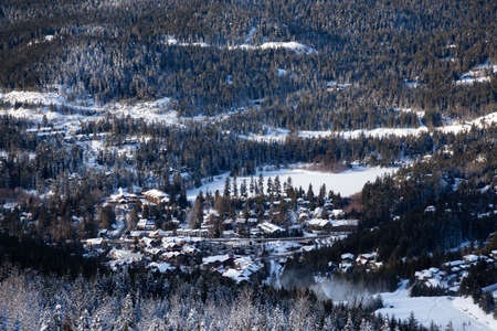 View from above of Creekside Village during a sunny winter day. Taken from Whistler Mountain, British Columbia, Canada.