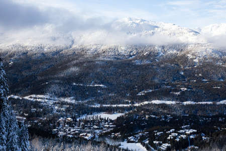 View from above of Creekside Village during a sunny winter day. Taken from Whistler Mountain, British Columbia, Canada. Stock Photo