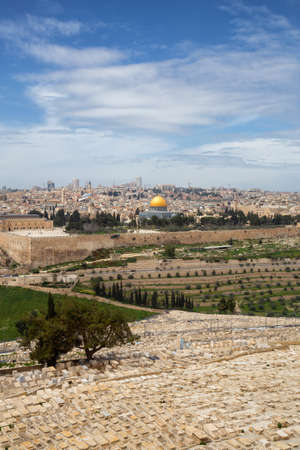 Beautiful aerial view of the Old City, Tomb of the Prophets and Dome of the Rock during a sunny and cloudy day. Taken in Jerusalem, Capital of Israel.