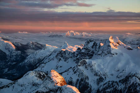 Aerial view of a beautiful Canadian Landscape during a winter sunset. Taken near Squamish, North of Vancouver, British Columbia, Canada.