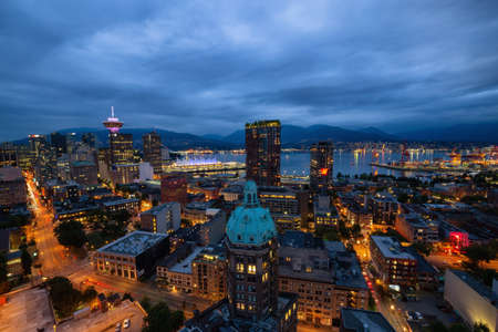 Downtown Vancouver, British Columbia, Canada - June 22, 2018: Aerial view of the modern city during night time after a cloudy sunset. Editorial