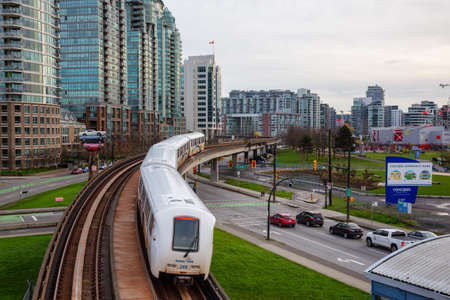 Downtown Vancouver, British Columbia, Canada - November 29, 2018: Skytrain passing in the modern city during a cloudy evening. Redakční