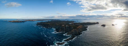 Aerial view of a rocky Atlantic Ocean Coast during a cloudy sunset. Taken in Twillingate, Newfoundland, Canada. Archivio Fotografico