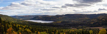 Panoramic view of a beautiful Canadian Landscape during a vibant sunny day in Fall Season. Taken in Gros Morne National Park, Newfoundland, Canada.