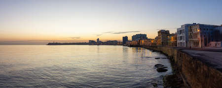 Beautiful panoramic view of the Old Havana City, Capital of Cuba, by the Ocean Coast during a vibrant sunny sunrise.