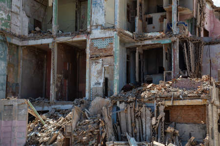 View of the broken and demolished residential homes in the Old Havana City, Capital of Cuba, during a cloudy and sunny day.