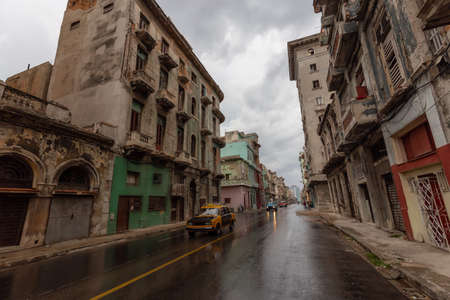 Street view of the beautiful Old Havana City, Capital of Cuba, during a wet and rainy day. Banco de Imagens