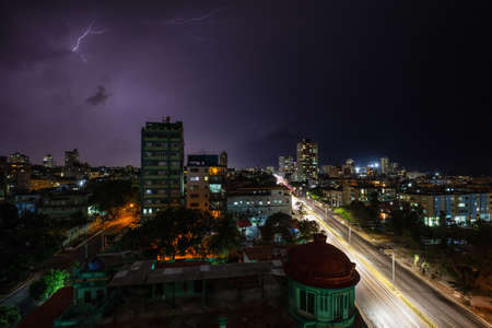 Aerial view of the Havana City, Capital of Cuba, during a Dramatic Thunderstorm with Lightening at night.