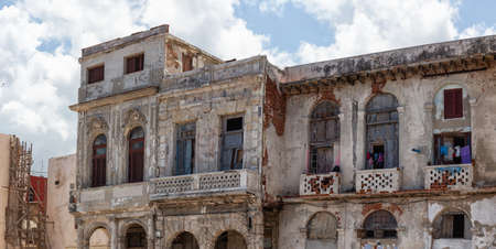 Panoramic View of the ancient residential homes in the Old Havana City, Capital of Cuba, during a cloudy and sunny day. Banco de Imagens