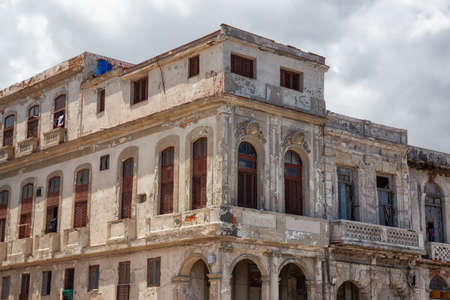 View of the ancient residential homes in the Old Havana City, Capital of Cuba, during a cloudy and sunny day.