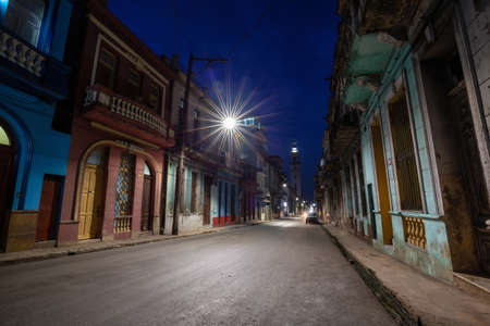 Street view of the residential neighborhood in the Old Havana City, Capital of Cuba, during night time after sunset. Banco de Imagens