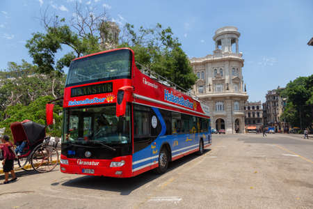 Havana, Cuba - May 19, 2019: Touristic Bus Tour, Hop on Hop Off, in the streets of the Old Havana City during a vibrant and bright sunny day.