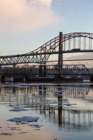 Beautiful View of Fraser River and Pattullo Bridge in the City during a cold and icy winter sunset. Taken in New Westminster, Vancouver, British Columbia, Canada.
