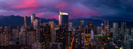 Aerial Panorama of the beautiful modern downtown city during the night after sunset. Vancouver, British Columbia, Canada. Colorful Clouds Composite