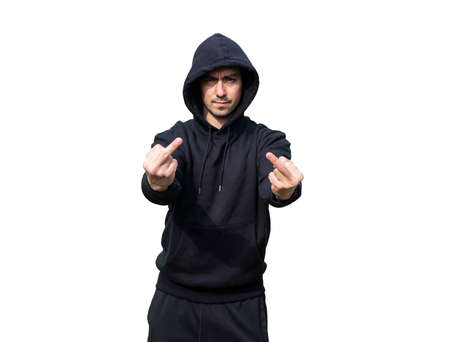 Young Caucasian Adult Man wearing black sweat pants and hoody is showing Two Middle Fingers. Isolated on White Background. Perfect for image composite