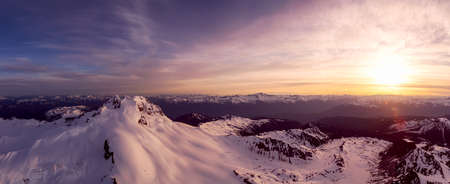 Aerial Panoramic View of Canadian Mountain Landscape during a colorful sunset. Located in Garibaldi near Whistler and Squamish, North of Vancouver, British Columbia, Canada. Nature Background Panorama Stock Photo