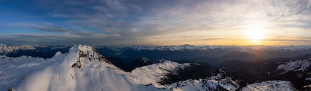 Aerial Panoramic View of Canadian Mountain Landscape during a colorful sunset. Taken in Garibaldi, near Whistler and Squamish, North of Vancouver, British Columbia, Canada. Nature Background Panorama