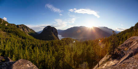 Beautiful Panoramic View of Canadian Mountain Landscape during a sunny sunset. Squamish, British Columbia, Canada. Nature Background Panorama