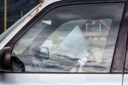 Funny and Sad Picture of a Dog with a Collar sitting on a driver seat in a car. Stock fotó