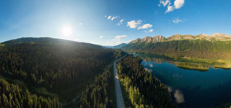 Beautiful, Serene Panoramic Road View with Mountains, Islands and Lakes on a Sunny Summer Day. Aerial shot near Pine Le Moray, and Powder King Moutain. John-Hart Highway, British Columbia. Stock fotó