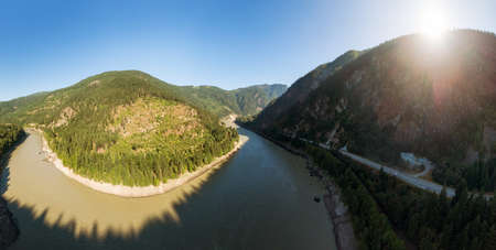 Beautiful Panoramic View of Canadian Nature and a Scenic Road, Trans-Canada Hwy, during sunny summer day. Aerial Drone Shot. North of Hope, BC, Canada.