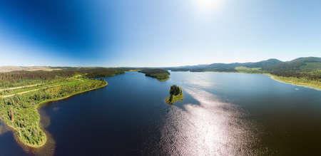 Scenic Panoramic Lake View Landscape of Canadian Nature on a Summer Day. Aerial Drone Shot. Kerry Lake, North of Prince George, John-Hart Highway, British Columbia. Stock fotó