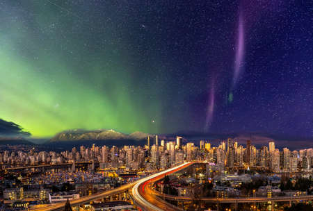 Downtown Vancouver, British Columbia, Canada. Beautiful Aerial Panoramic View of a Modern City. Cityscape Skyline. During Colorful Night with aurora borealis Composite. Dreamscape