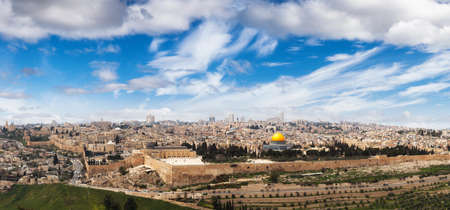Beautiful panoramic aerial view of the Old City, Tomb of the Prophets and Dome of the Rock. Blue Sunny and Cloudy Sky Overlay. Jerusalem, Capital of Israel. Historic Architecture Banco de Imagens
