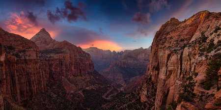 Beautiful aerial panoramic landscape view of a Canyon. Dramatic Colorful Summer Sunset Artistic Render. Taken in Zion National Park, Utah, United States.