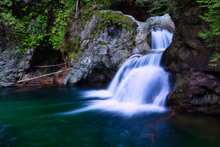 Beautiful Waterfalls in Lynn Valley Canyons, North Vancouver, British Columbia, Canada. Colorful Artistic Render