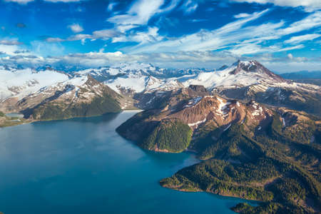 Beautiful aerial landscape view of a famous Canadian landmark, Garibaldi Lake. Dramatic Blue Sky Artistic Render. Taken near Whistler and Squamish, North of Vancouver, BC, Canada. Stock Photo