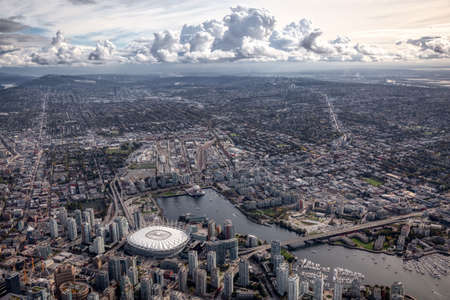 Aerial view of the City Buildings in Vancouver Downtown , British Columbia, Canada. Sunny Cloudy Morning. Modern Cityscape 版權商用圖片