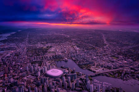 Aerial view of the City Buildings in Vancouver Downtown , British Columbia, Canada. Colorful Dramatic Sunrise Artistic Render. Modern Cityscape