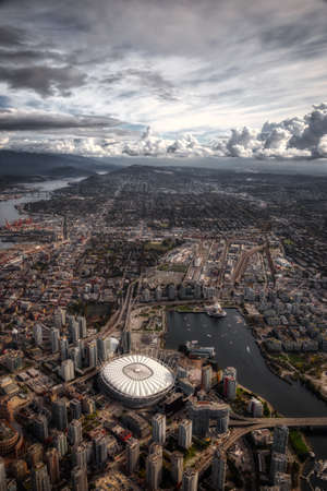 Aerial view of the City Buildings in Vancouver Downtown , British Columbia, Canada. Cloudy Morning dramatic artistic Render. Modern Cityscape
