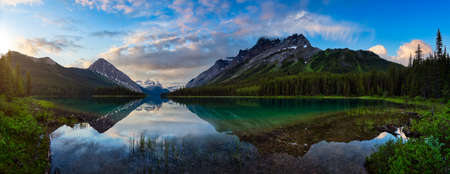 Panoramic View of Beautiful Marvel Lake surrounded by Canadian Rocky Mountains. Colorful Cloudy Sunrise. Located near Banff, boarder of British Columbia and Alberta, Canada. Nature Background Panorama