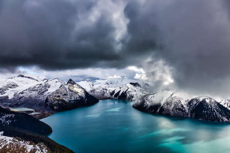 Beautiful landscape view of Garibaldi Lake vibrant cloudy fall season day. Taken from top of Panorama Ridge, located near Whister and Squamish, North of Vancouver, BC, Canada.
