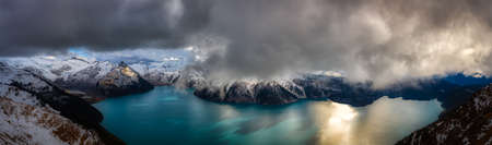 Beautiful Panoramic landscape view of Garibaldi Lake vibrant cloudy fall season day. Taken from top of Panorama Ridge, located near Whister and Squamish, North of Vancouver, BC, Canada.