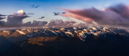 Aerial Panoramic View of Canadian Mountain Landscape. Dramatic Cloudy Sunrise Art Render. Located near Vancouver, British Columbia, Canada. Nature Panorama Background 版權商用圖片