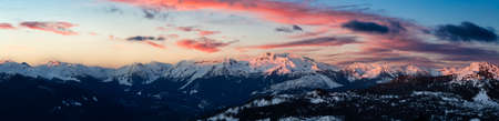 Beautiful Aerial Panoramic View of Canadian Mountain Landscape. Dramatic Sunset Sky Art Render. Taken in Squamish, North of Vancouver, British Columbia, Canada. Nature Background Panorama